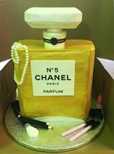 Chanel Bottle Cake with makeup