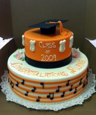 Black and Orange Grad Cake with Musical Notes